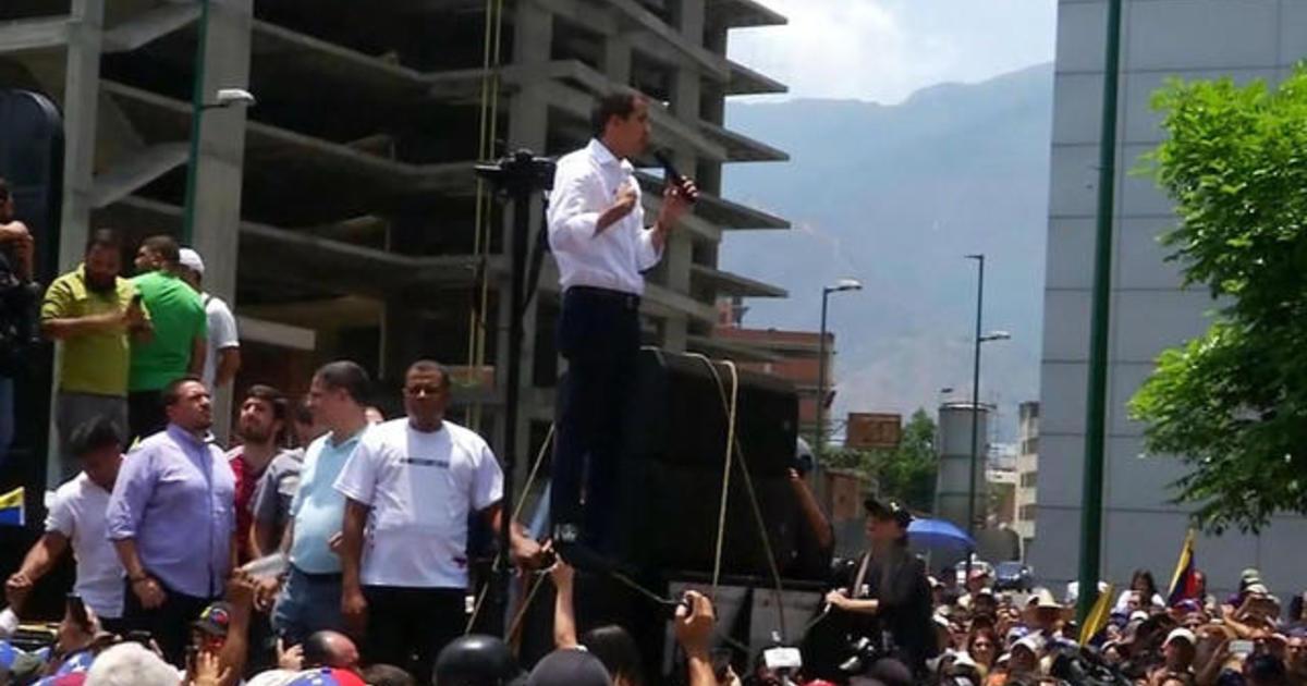 Dozens injured in clashes in Caracas, Venezuela - CBS News