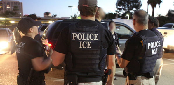 Officer suspended for cooperating with ICE restored - WND
