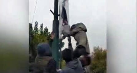 Iconic moment: Defiant Iranian woman rips down anti-American poster - WND