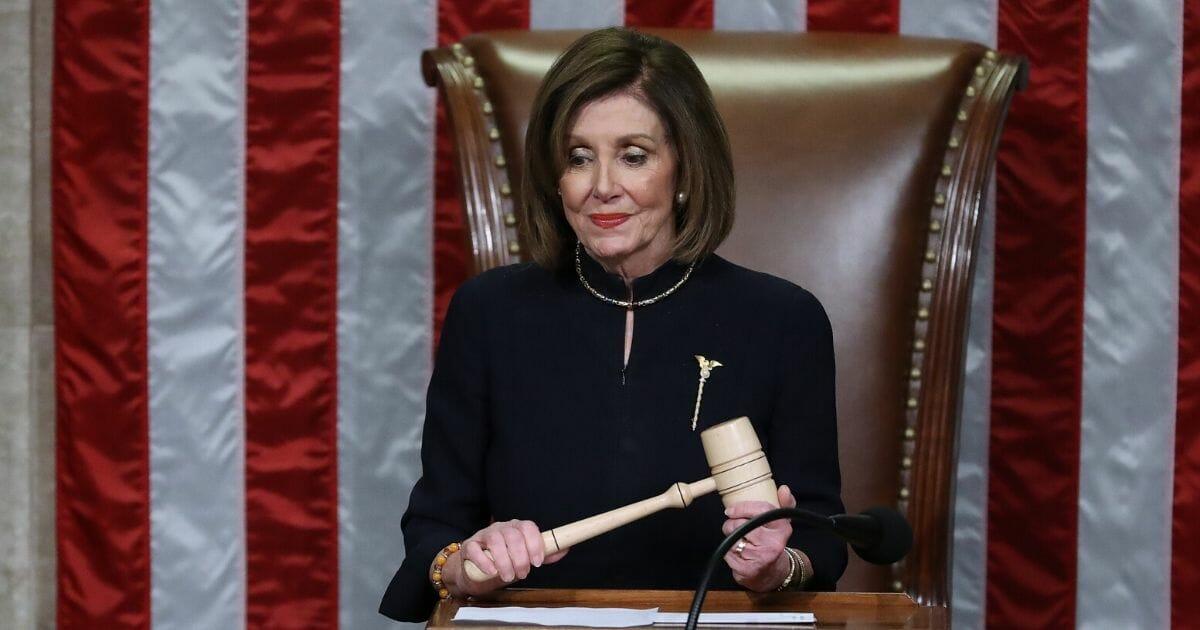 Nancy Pelosi Says She'll Delay Sending Impeachment to Senate Until a 'Fair' Trial Can Occur