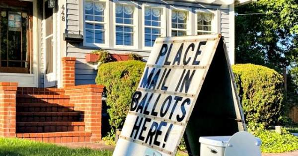 Democrat Calls Cops on Toilet Lawn Display Mocking Mail-In Voting