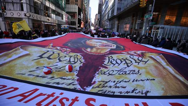 Trump supporters clash with ANTIFA in Manhattan after unfurling a huge flag of Pelosi as a demon outside Trump Tower